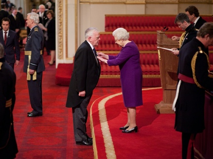 Dr Paul Doherty receiving his OBE